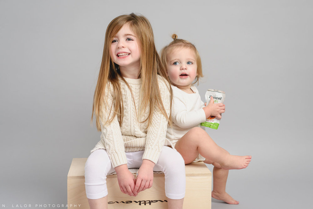 Two sisters, just sitting around. Studio portrait by N. Lalor Photography, Greenwich CT family photographer.