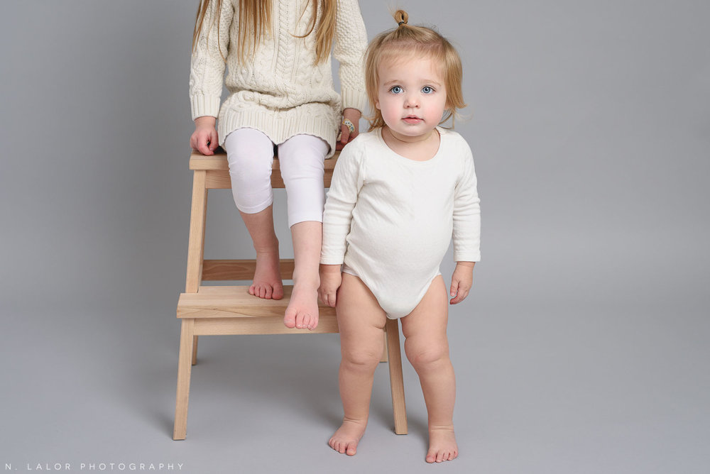 Sisters. Studio portrait by N. Lalor Photography, Greenwich CT family photographer.