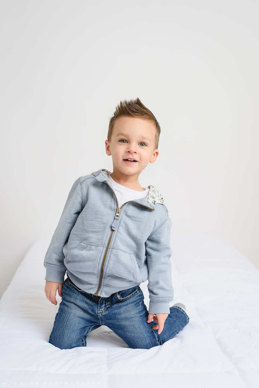 Being a 3-year old boy. Studio portrait by N. Lalor Photography in Greenwich, Connecticut.