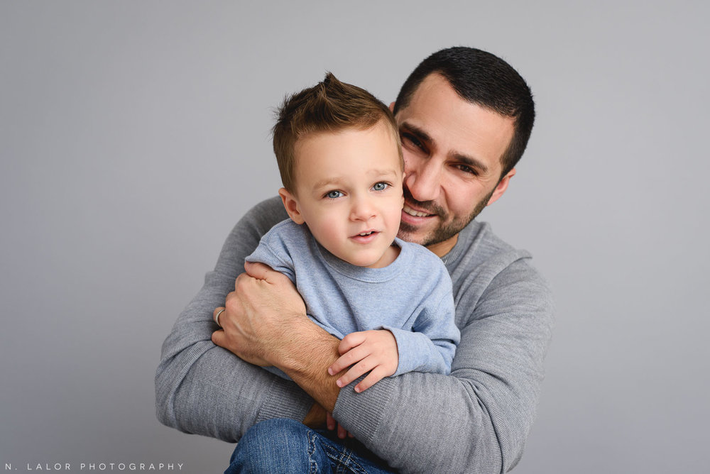 Dad and his oldest son. Studio portrait by N. Lalor Photography in Greenwich, Connecticut.