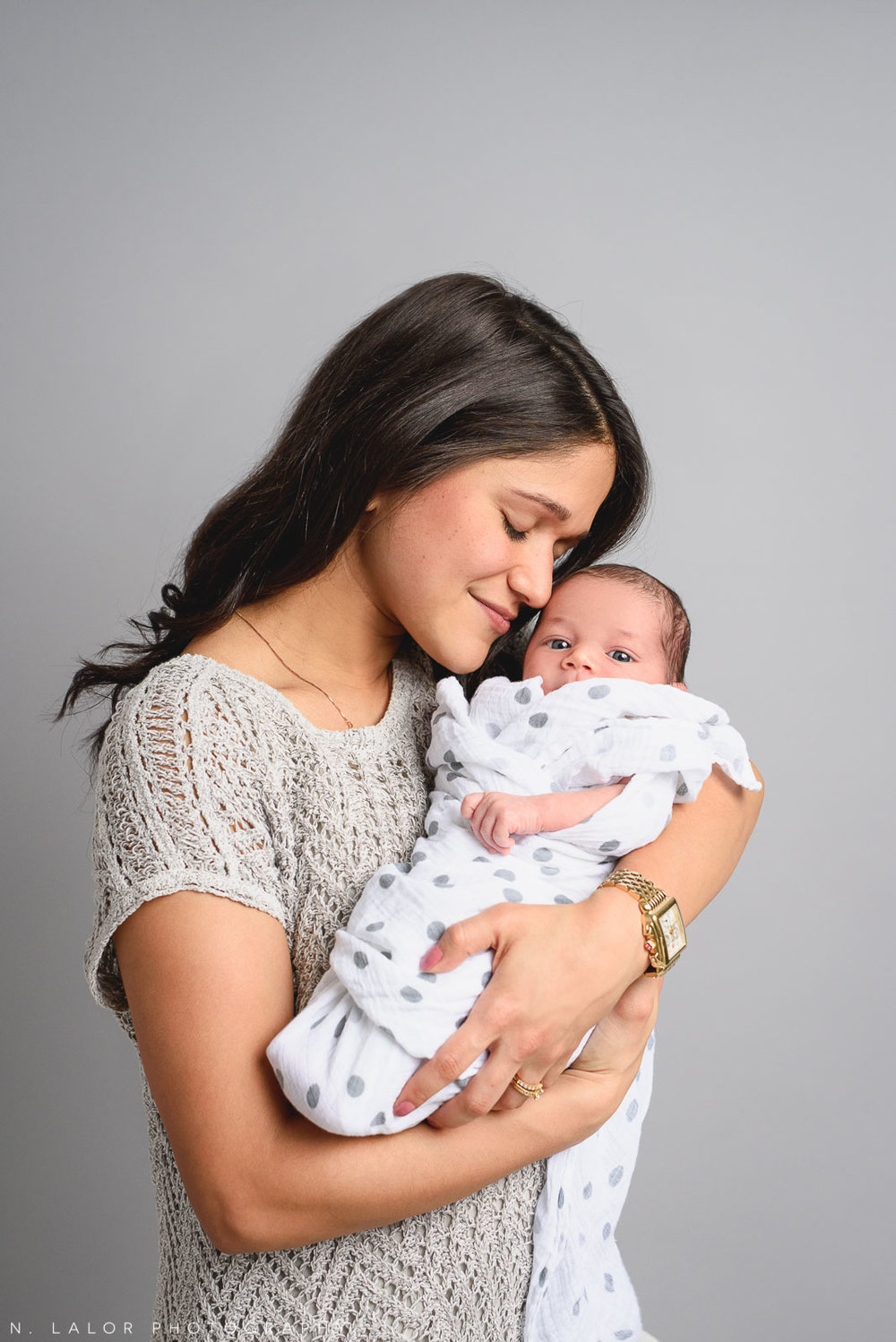 Beautiful Mom and daughter. Studio newborn photo session with N. Lalor Photography in Greenwich, Connecticut.