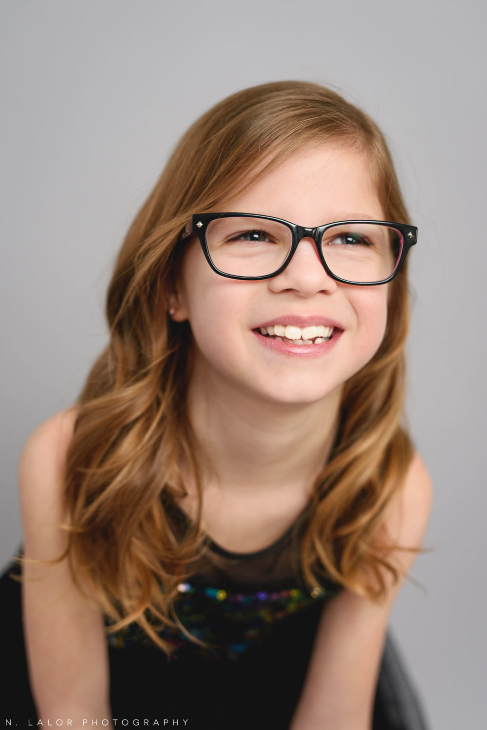 Laughter and glasses. Tween photo session with N. Lalor Photography. Studio located in Greenwich, Connecticut.