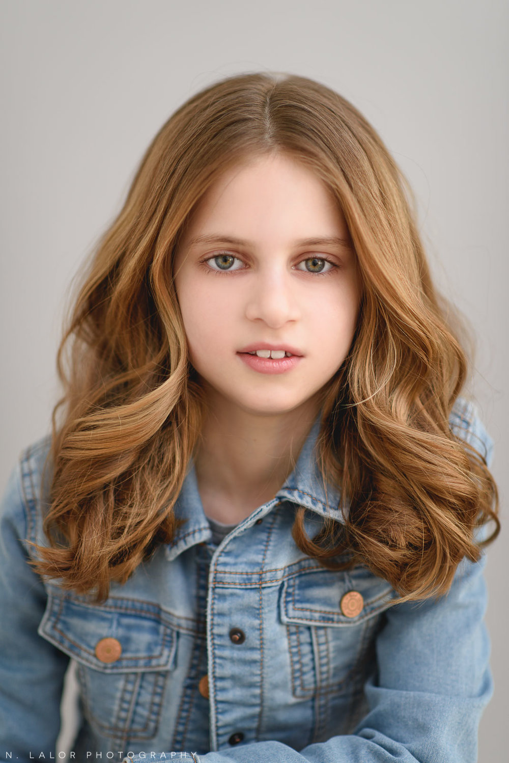 Simple, beautiful headshot of a tween girl. Tween Studio photoshoot by N. Lalor Photography, located in Greenwich, CT.