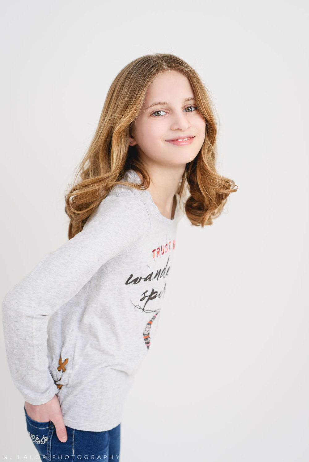 Smiles. Tween Studio photoshoot by N. Lalor Photography, located in Greenwich, CT.