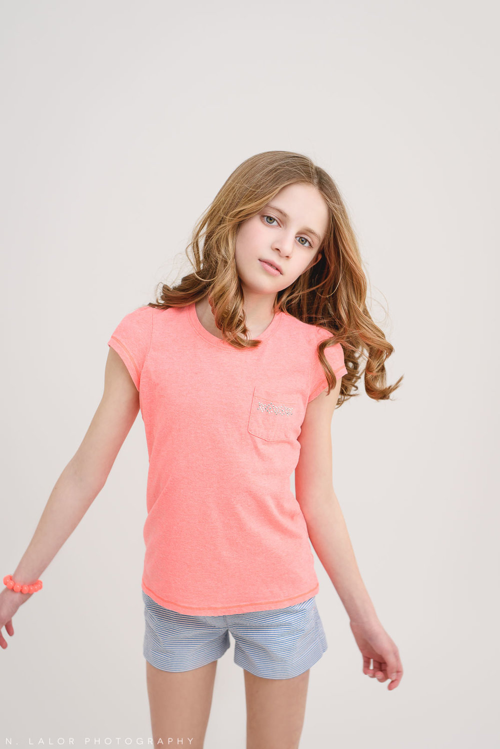 Natural candid portrait. Tween Studio photoshoot by N. Lalor Photography, located in Greenwich, CT.