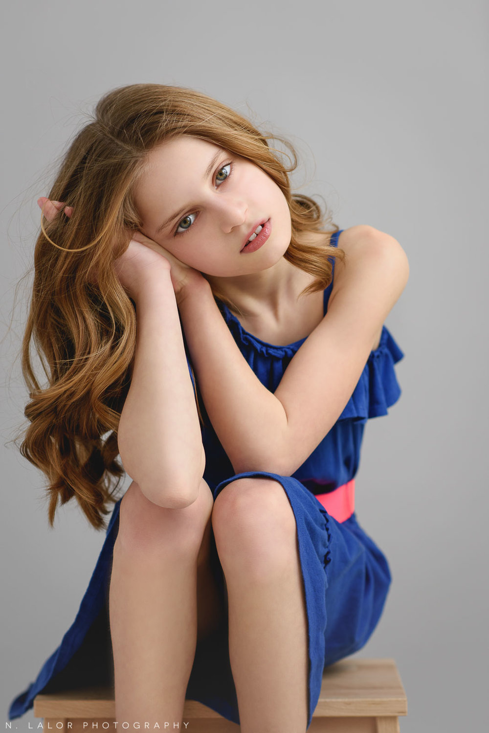 Sitting pose. Tween Studio photoshoot by N. Lalor Photography, located in Greenwich, CT.