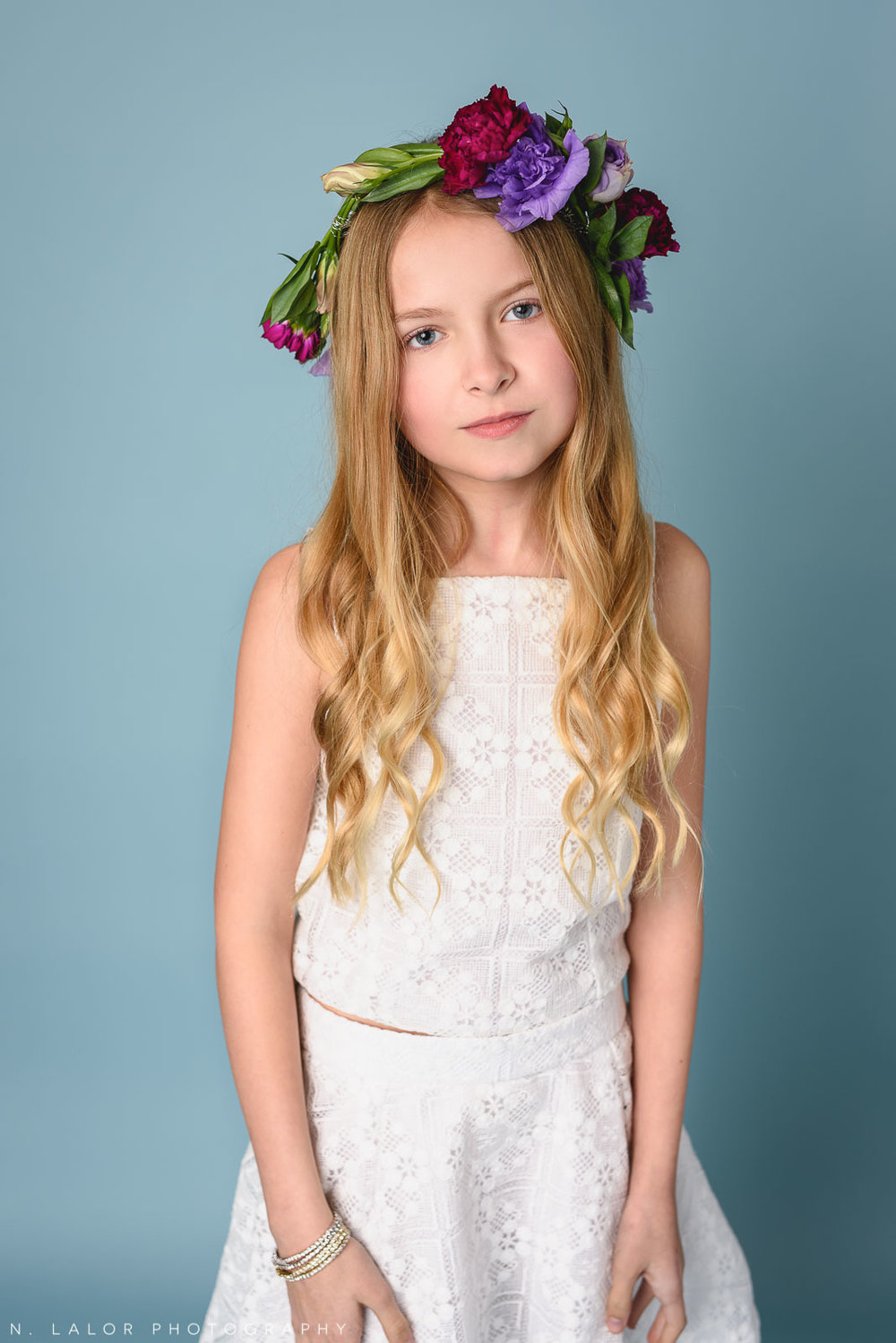 White Stella M'Lia dress and flower crown. Tween fashion portrait by N. Lalor Photography. New Canaan, Connecticut.
