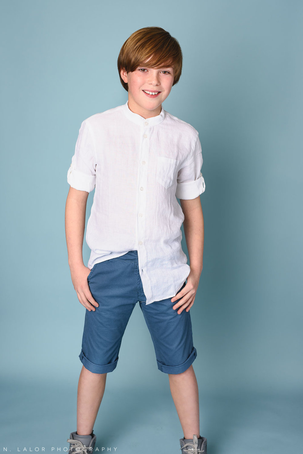 Linen shirt and summer shorts. Boy fashion portrait by N. Lalor Photography. New Canaan, Connecticut.