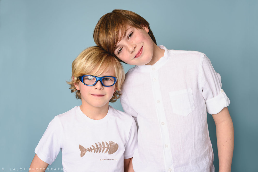 Stylish brothers. Kids fashion portrait by N. Lalor Photography. New Canaan, Connecticut.