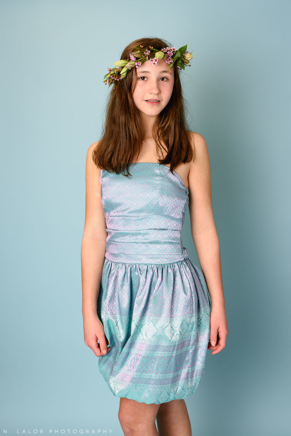 Beautiful and confident, wearing a Stella M'Lia dress. Tween girl fashion portrait by N. Lalor Photography. New Canaan, Connecticut.