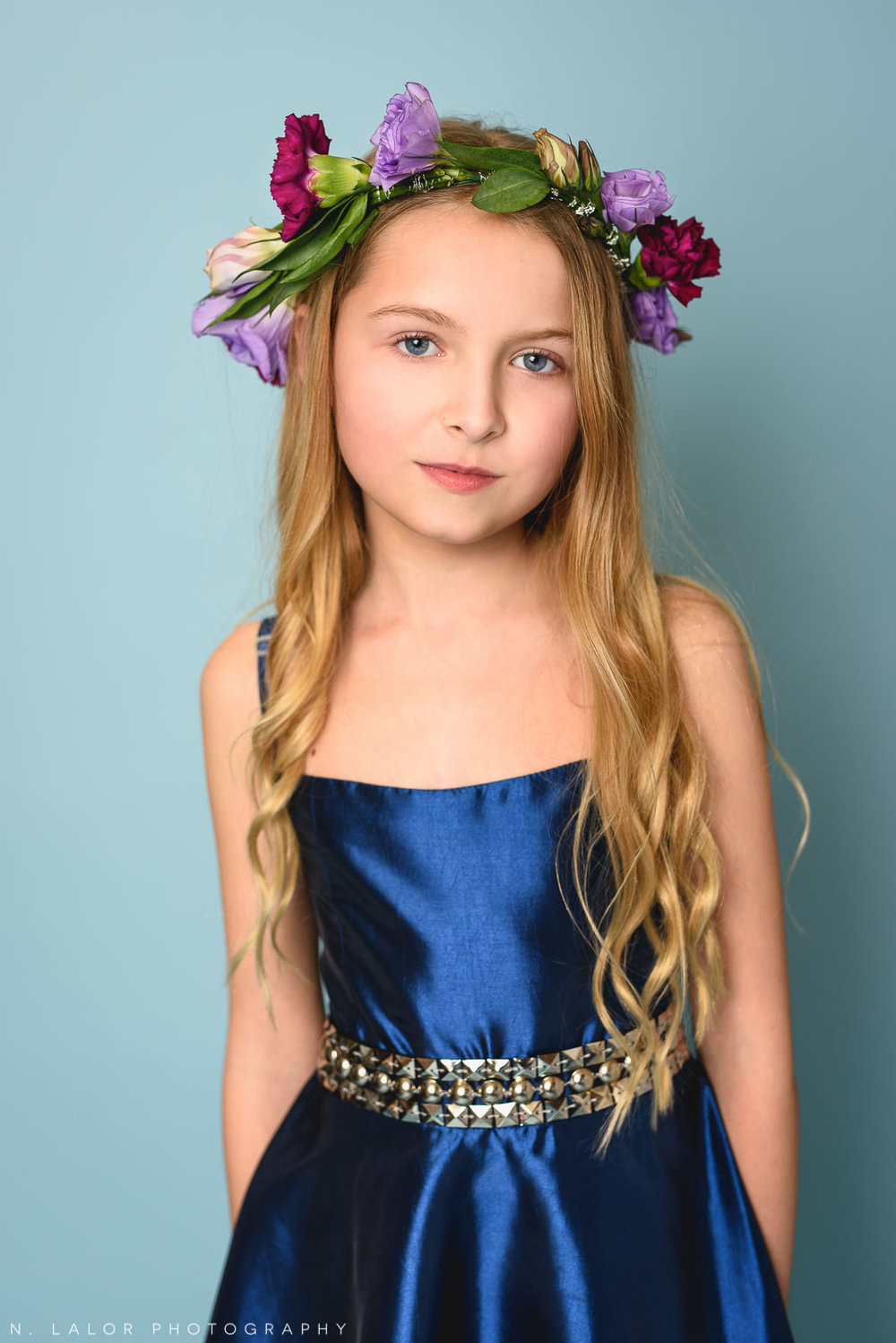 Rich blue Stella M'Lia dress with a flower crown. Tween girl fashion portrait by N. Lalor Photography. New Canaan, Connecticut.