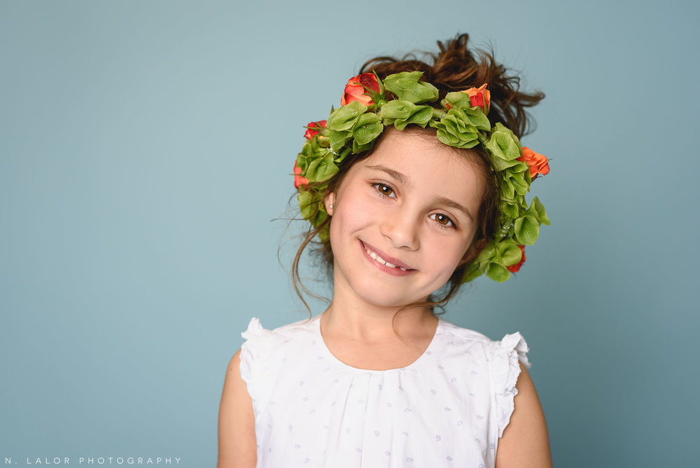 Pretty with a flower crown. Kids fashion portrait by N. Lalor Photography. New Canaan, Connecticut.