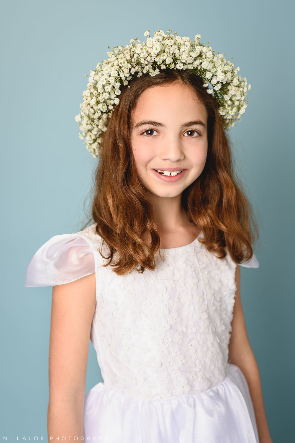 Ready for first communion. Dress by Stella M'Lia. Tween girl fashion portrait by N. Lalor Photography. New Canaan, Connecticut.