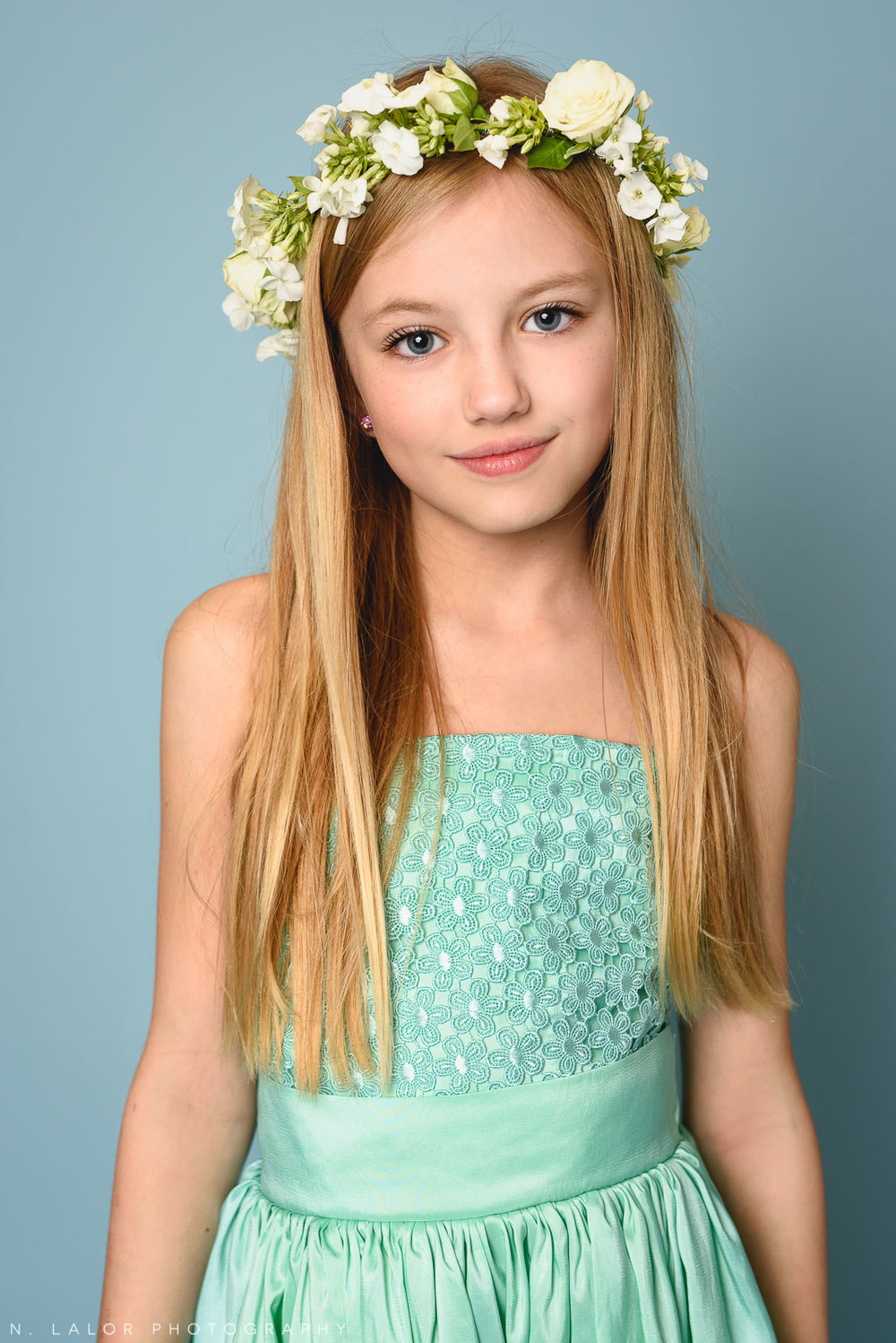 Spring flower crown and a green Stella M'Lia dress. Tween girl fashion portrait by N. Lalor Photography. New Canaan, Connecticut.