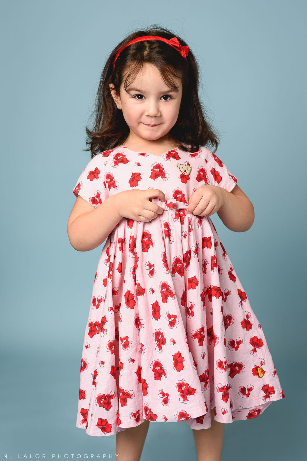 Pink hearts dress. Kids fashion portrait by N. Lalor Photography. New Canaan, Connecticut.