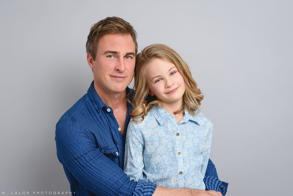 A portrait of Dad and his daughter. Studio family photoshoot with N. Lalor Photography in Riverside, Connecticut.