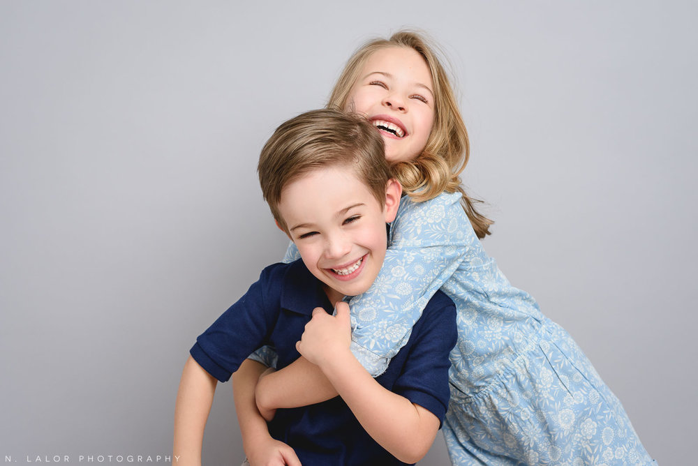 Brother and sister. Studio family photoshoot with N. Lalor Photography in Riverside, Connecticut.