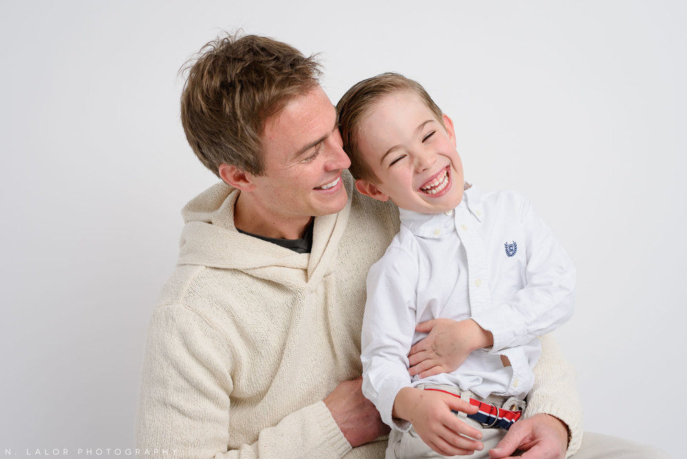 Dad and son, a candid moment. Studio family photoshoot with N. Lalor Photography in Riverside, Connecticut.