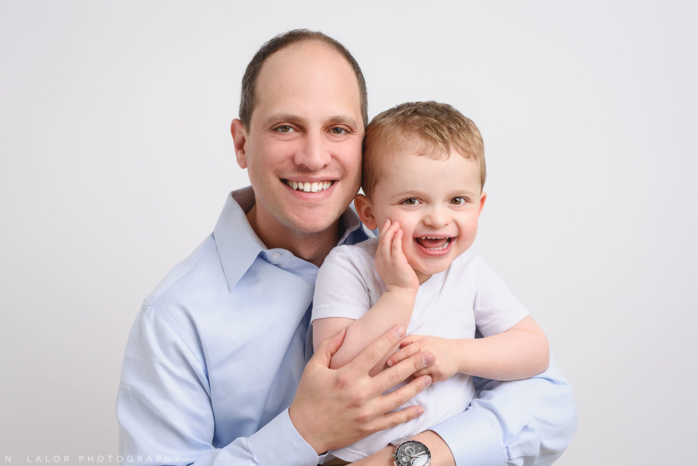 Dad with his son. Studio family photo session with N. Lalor Photography in Greenwich, Connecticut.