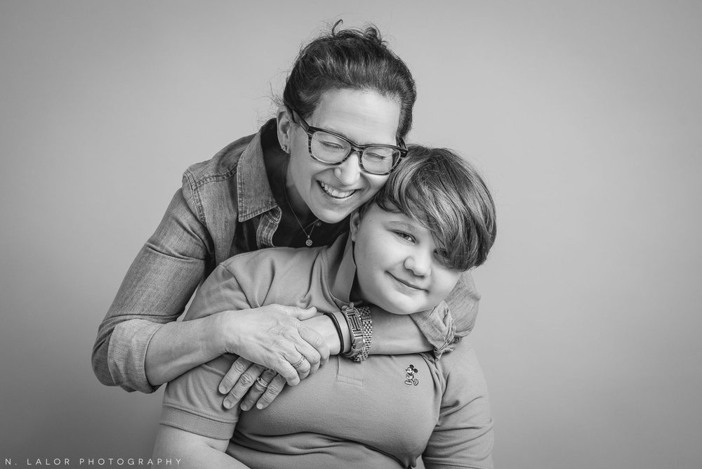 Mom with her son. Teen family photo session with N. Lalor Photography. Greenwich, Connecticut studio photographer.