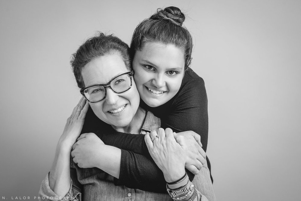 Mom with her daughter. Teen family photo session with N. Lalor Photography. Greenwich, Connecticut studio photographer.