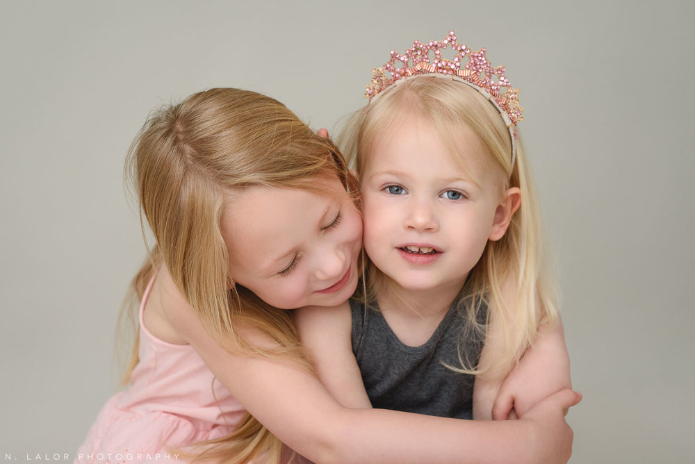 Sisters. Family photo session with N. Lalor Photography. Greenwich, Connecticut studio photographer.