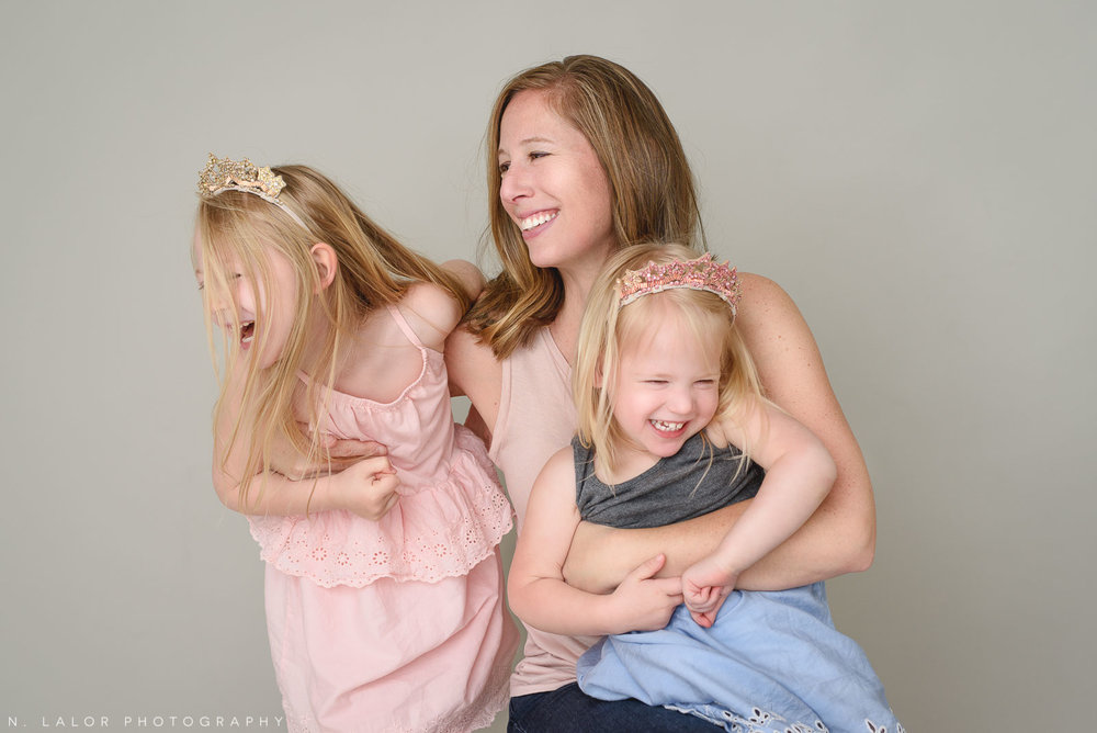 Mom with her daughters. Family photo session with N. Lalor Photography. Greenwich, Connecticut studio photographer.