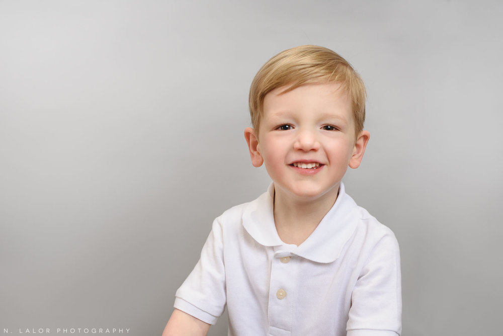 Soon to be big brother. Simple studio portrait by N. Lalor Photography. Taken in New Canaan, CT.