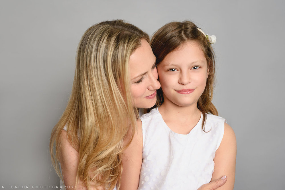 Mom with older daughter. Simple studio portrait by N. Lalor Photography. Taken in New Canaan, CT.
