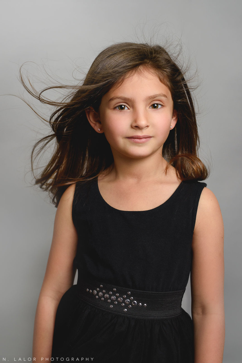 Beautiful young girl. Simple studio portrait by N. Lalor Photography. Taken in New Canaan, CT.