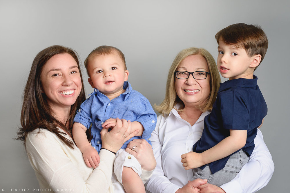 Mom, grandma, and two boys. Simple studio portrait by N. Lalor Photography. Taken in New Canaan, CT.