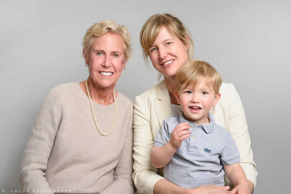 Mom, grandma, and young son. Simple studio portrait by N. Lalor Photography. Taken in New Canaan, CT.