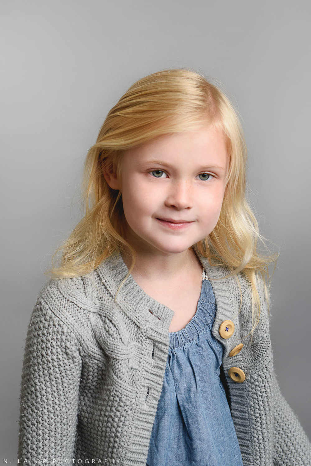 Older sister. Simple studio portrait by N. Lalor Photography. Taken in New Canaan, CT.