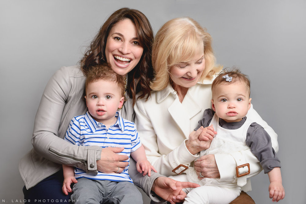 Mom with her twins and grandma. Simple studio portrait by N. Lalor Photography. Taken in New Canaan, CT.