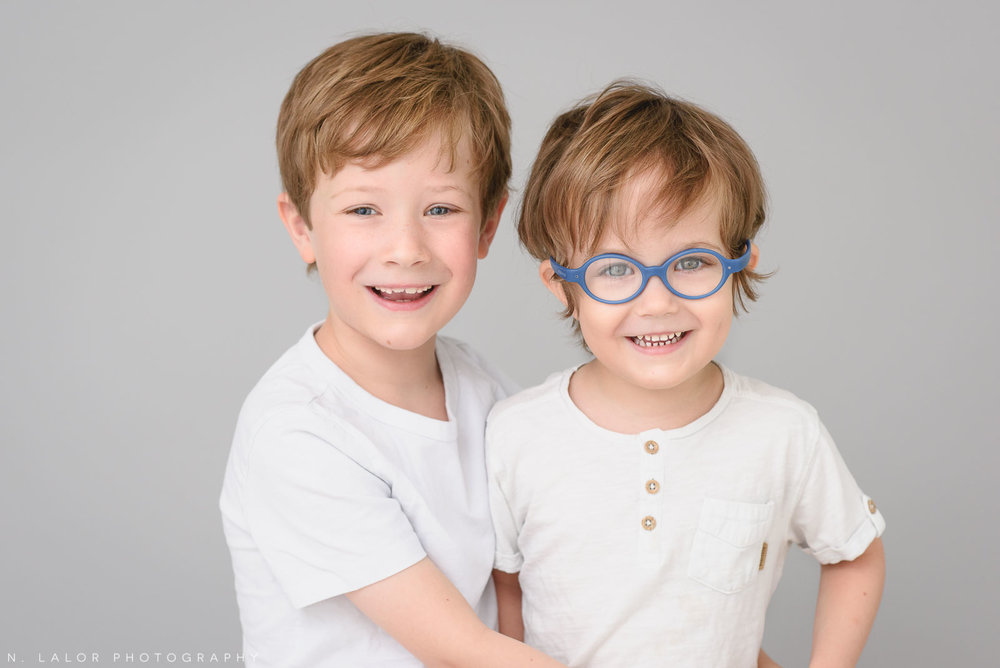 Happy brothers together. Simple studio portrait session with N. Lalor Photography in Greenwich, CT.