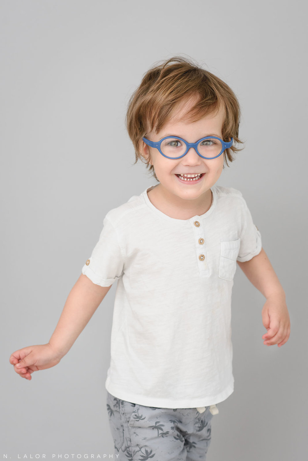 3-year old with glasses. Simple studio portrait session with N. Lalor Photography in Greenwich, CT.
