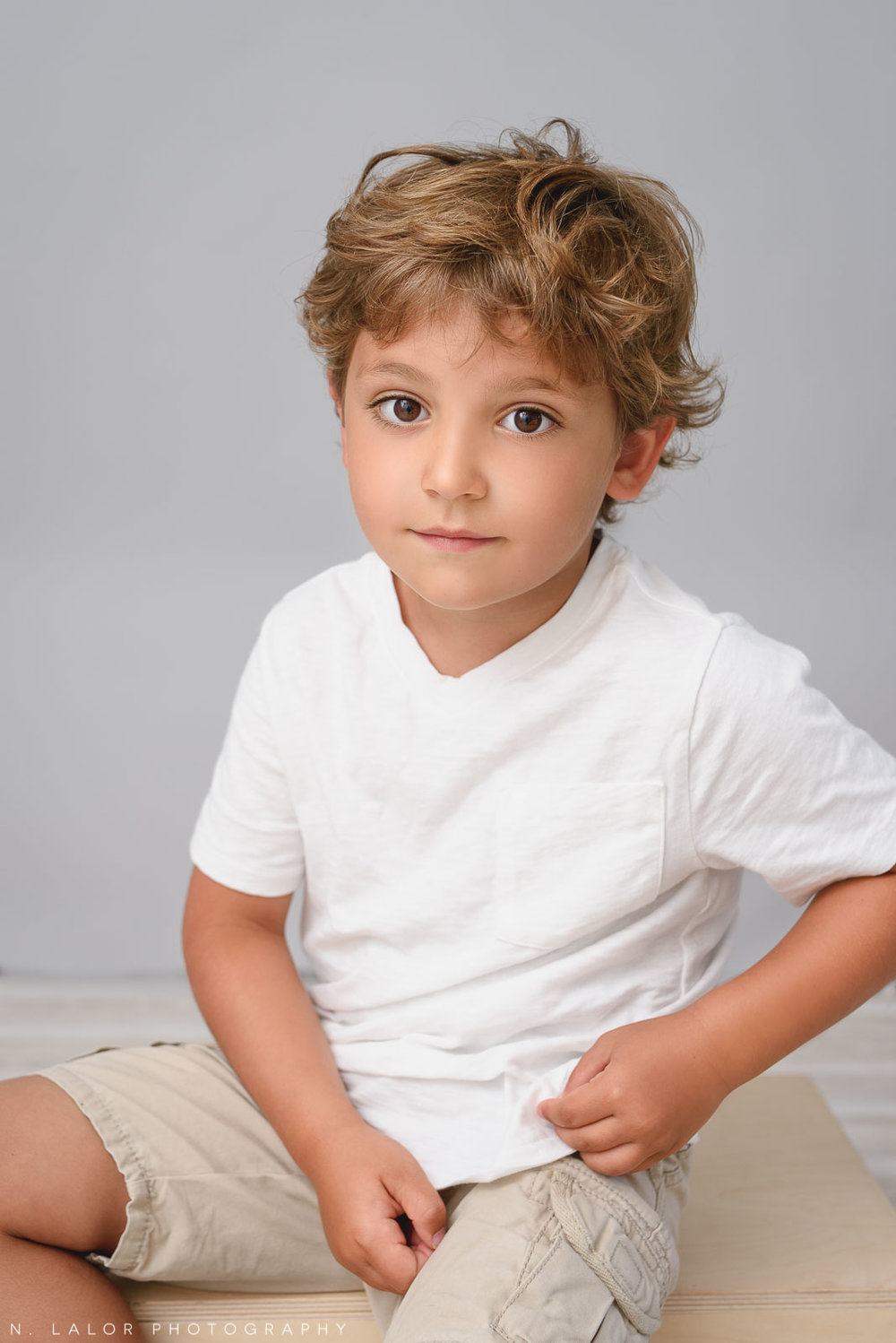 The thoughtful one. Family photo session by N. Lalor Photography in Greenwich, CT.