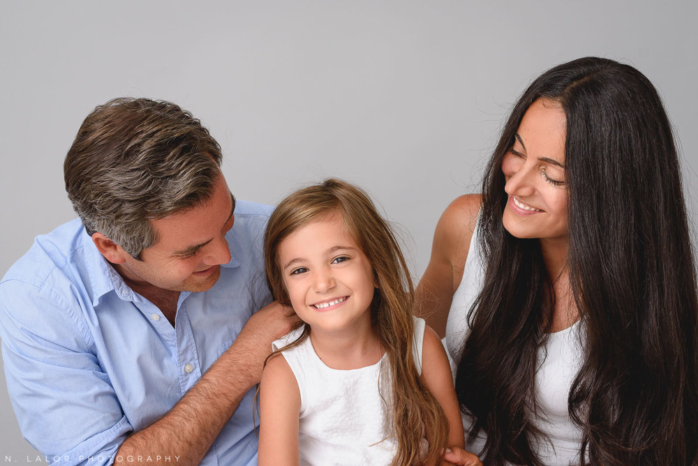 Young daughter with parents. Family photo session by N. Lalor Photography in Greenwich, CT.