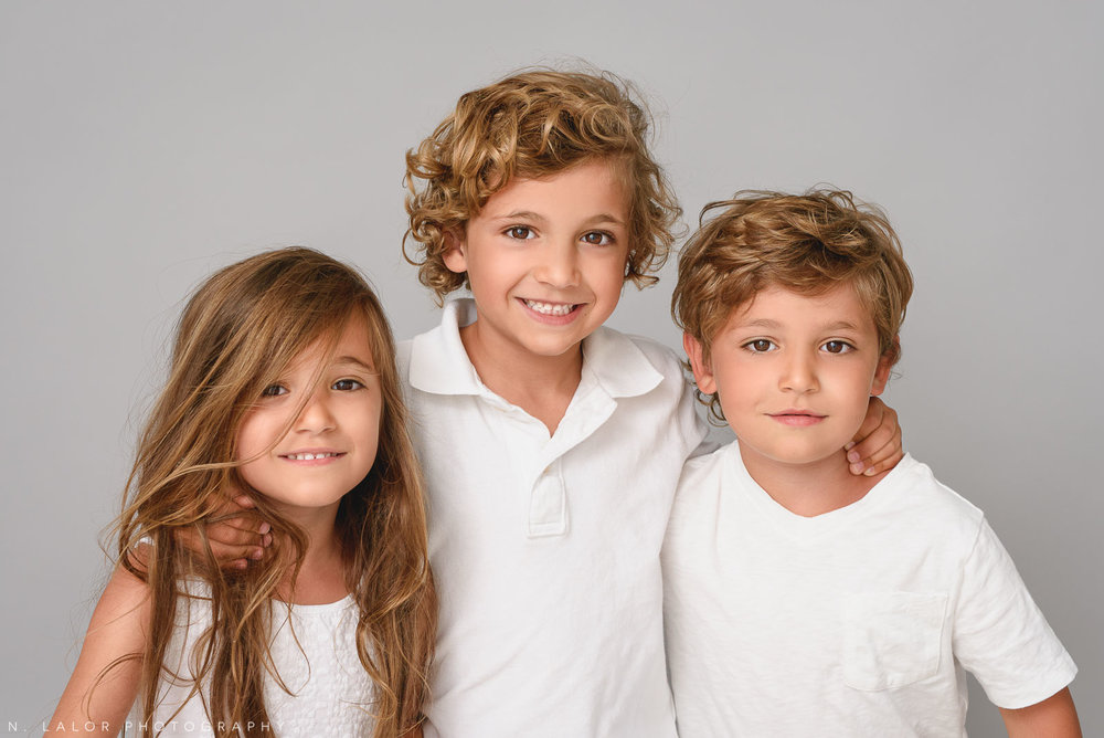 Three kids together. Family photo session by N. Lalor Photography in Greenwich, CT.