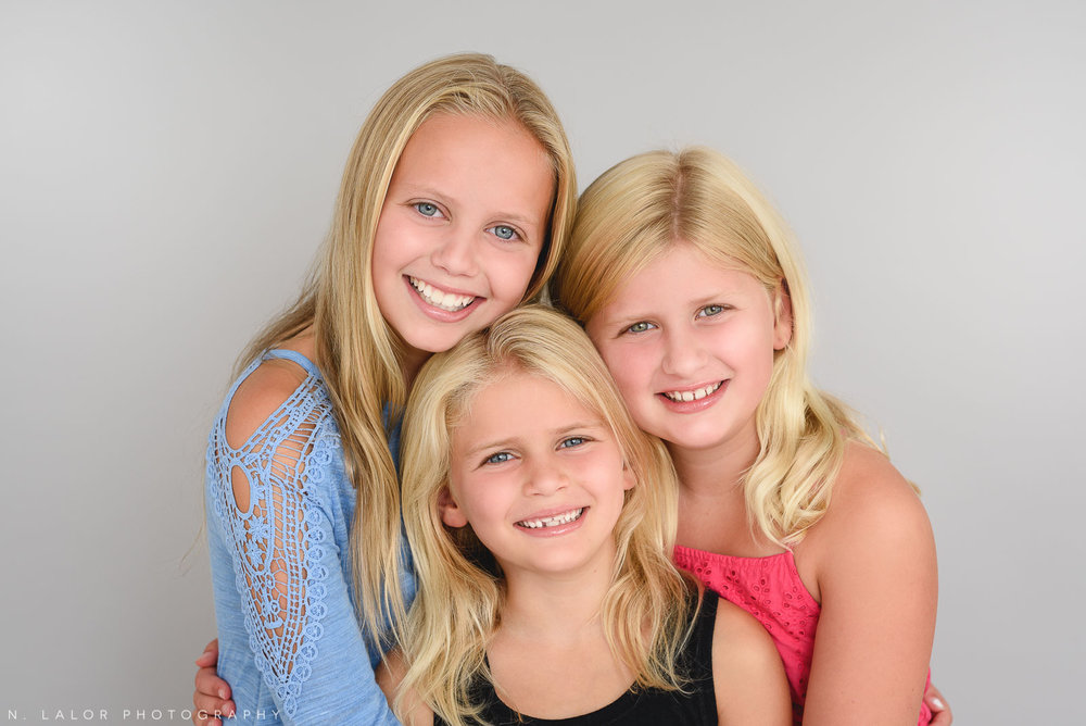 Three sisters together. Studio family photo session with N. Lalor Photography in Greenwich, Connecticut.
