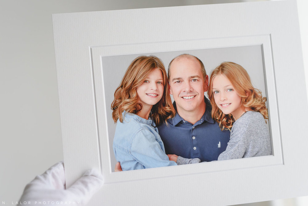 Dad with his two girls. Portrait by N. Lalor Photography in Greenwich, Connecticut.