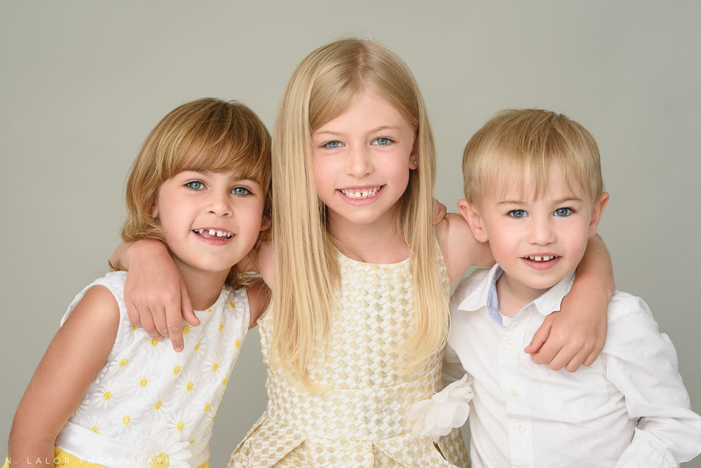 A photograph of three happy kids by N. Lalor Photography in Greenwich, Connecticut.