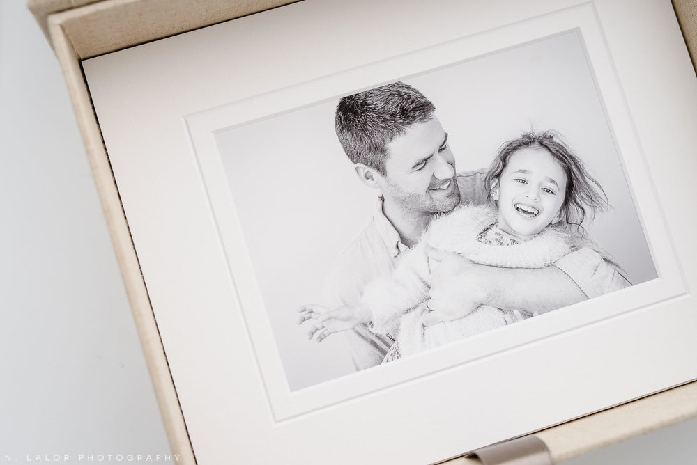 Photograph of a dad laughing with his daughter, printed and beautifully matted. Image by N. Lalor Photography, Greenwich Connecticut.