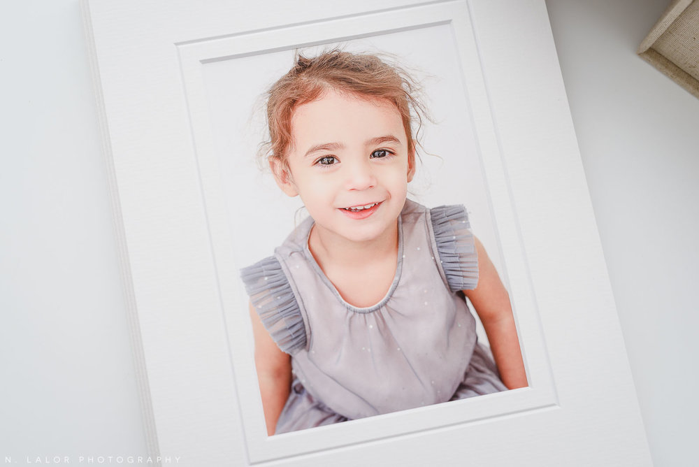Studio photograph of a young 2 year old girl, printed and beautifully matted. Image by N. Lalor Photography, Greenwich Connecticut.