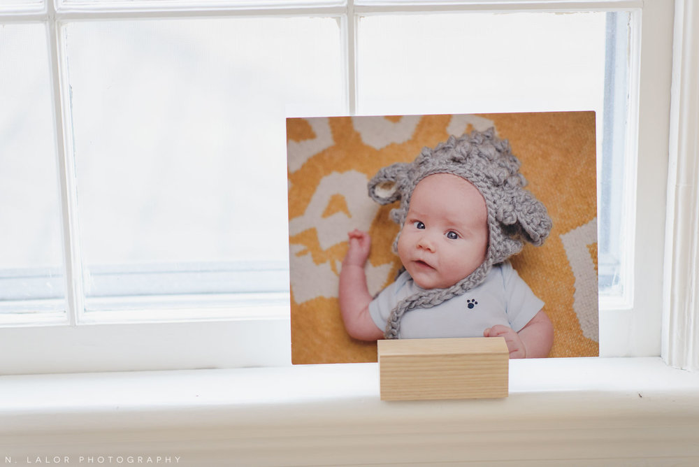 Picture of a baby photo print displayed on a window sill. Photograph by N. Lalor Photography.