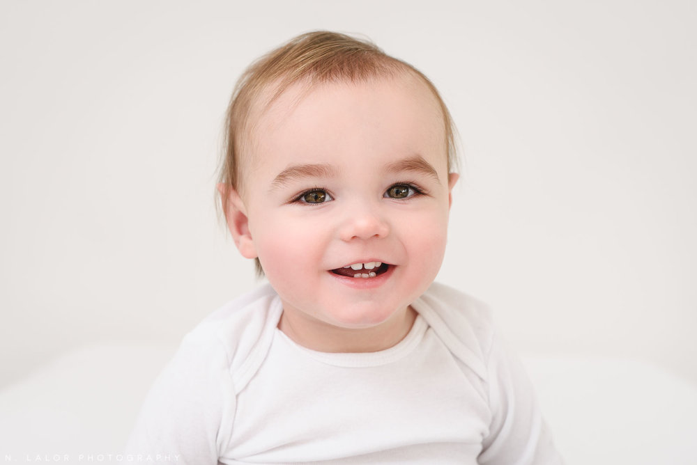 Cute baby boy smiling, 1 year old. Baby Milestone Session by N. Lalor Photography in Greenwich, Connecticut.