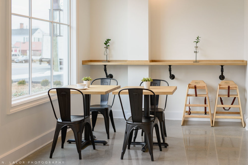 Interior shot of tables and chairs. Roost Darien, small business photos by N. Lalor Photography.