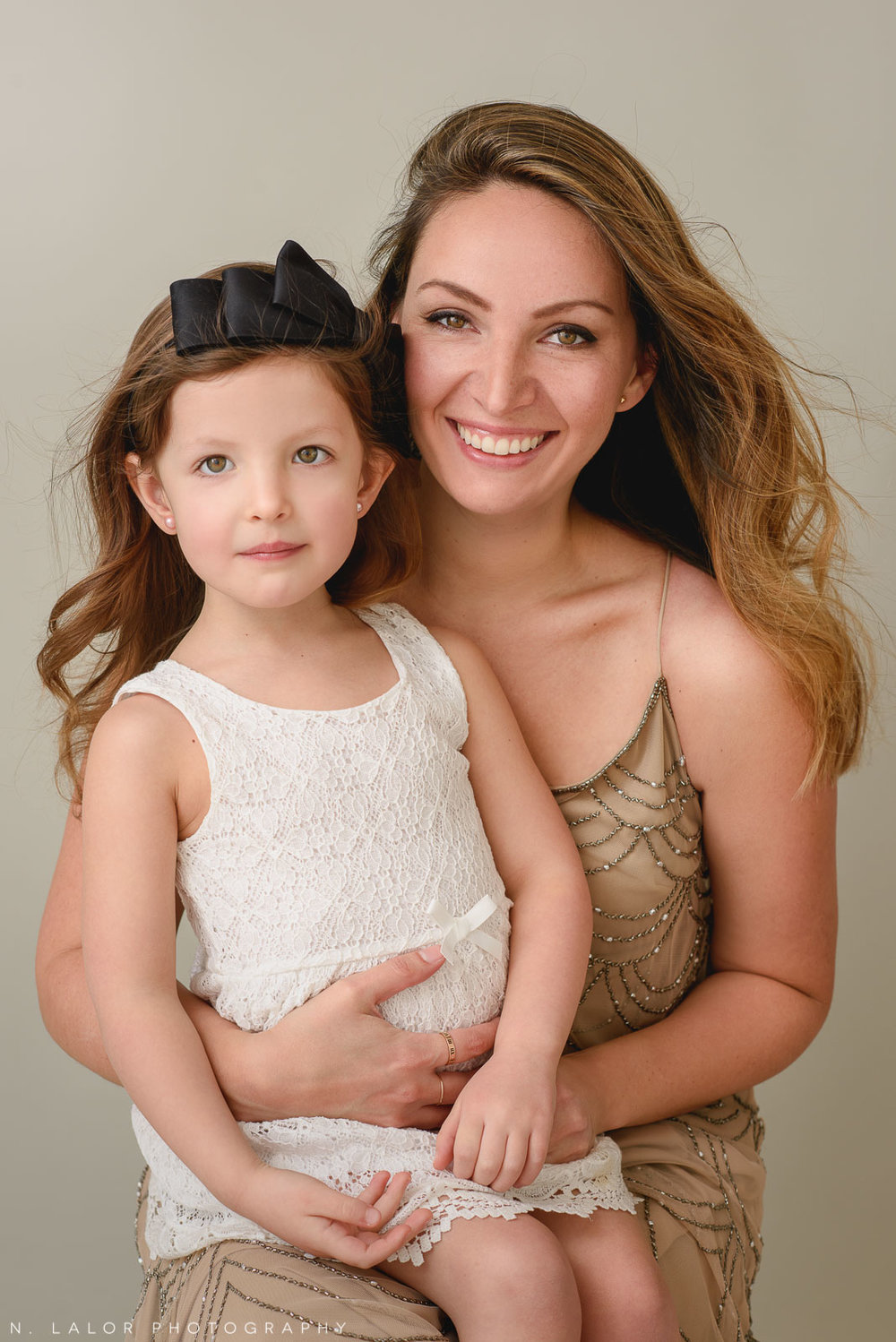 Image of Mom holding her daughter. A Mother and Daughter photoshoot with N. Lalor Photography in Greenwich, Connecticut.