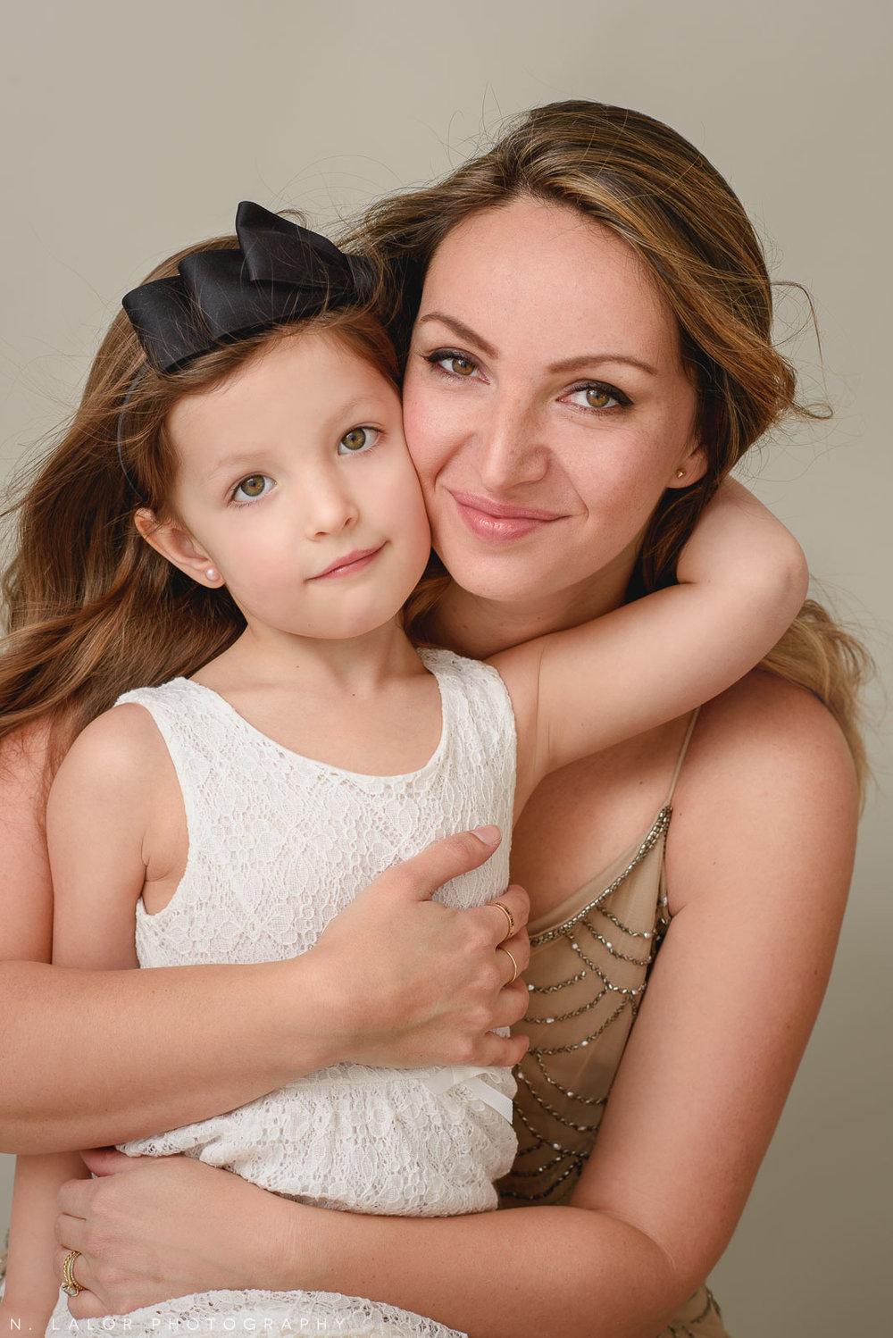 Beautiful Mom with her child. A Mother and Daughter photoshoot with N. Lalor Photography in Greenwich, Connecticut.