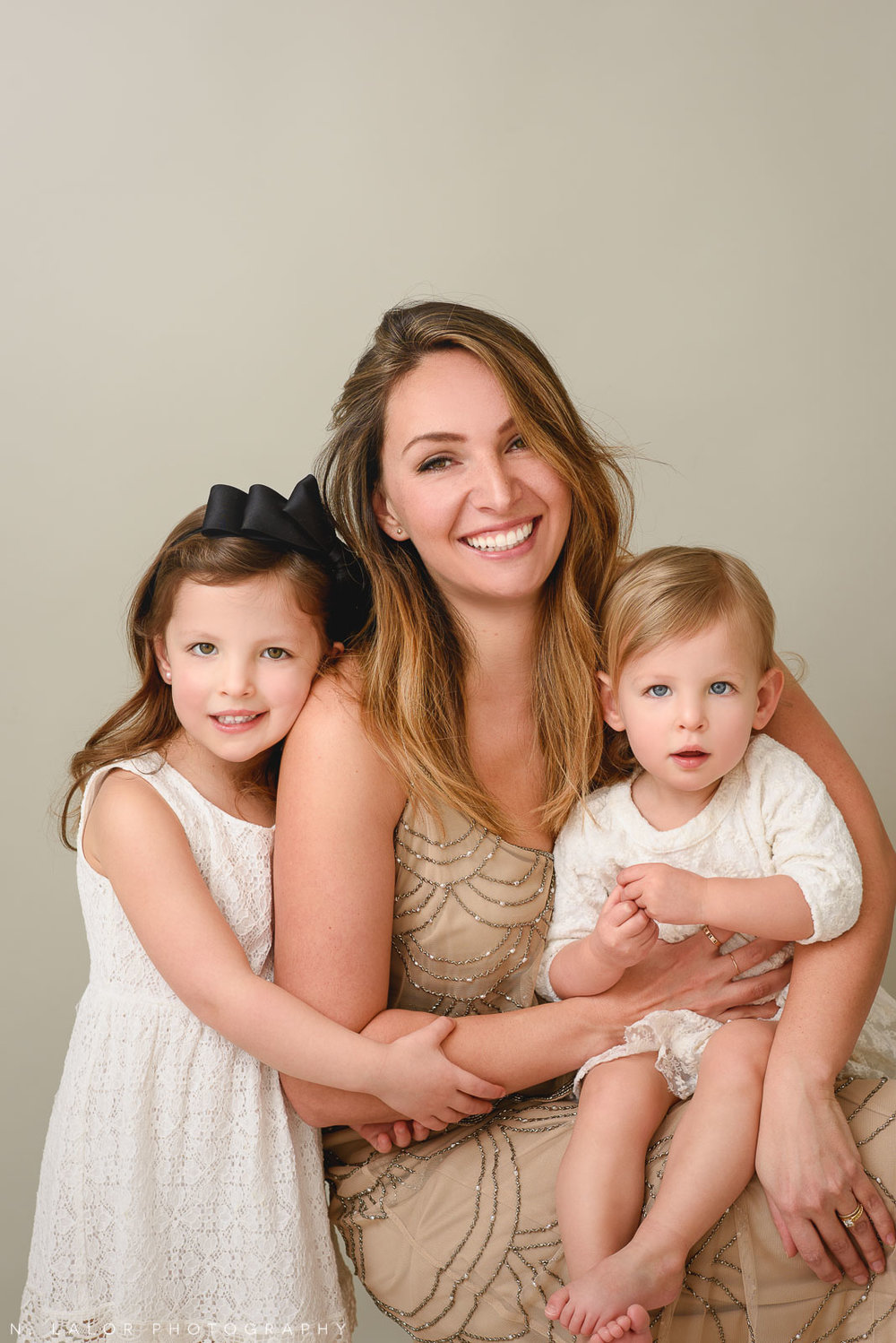 Mom with her two daughters. A Mother and Daughter photoshoot with N. Lalor Photography in Greenwich, Connecticut.